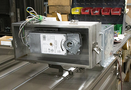 Electric actuators are tied to the damper's driving axle, so that all blades rotate on the same action.
